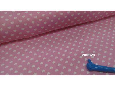Rózsaszín alapon fehér szivecskés falvédő