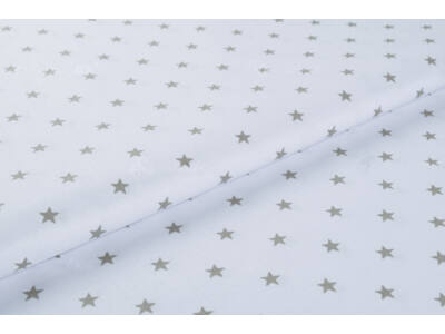 Fehér alapon szürke csillagos anyagból készült falvédő