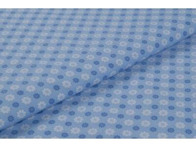 Kék virágos mintás anyagból készült falvédő
