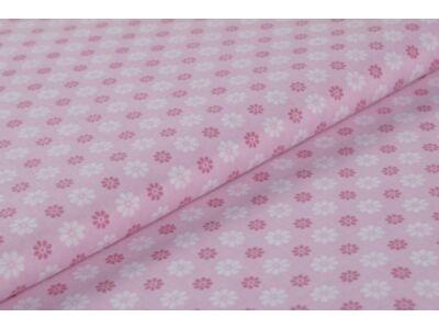 Rózsaszín virágos mintás anyagból készült falvédő
